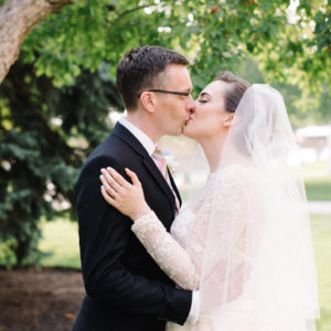 Lindsey + Anthony: Traditional British Wedding - Bride and groom kiss