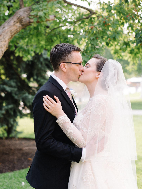 ed8e319271c Lindsey + Anthony  Traditional British Wedding - Bride and groom kiss