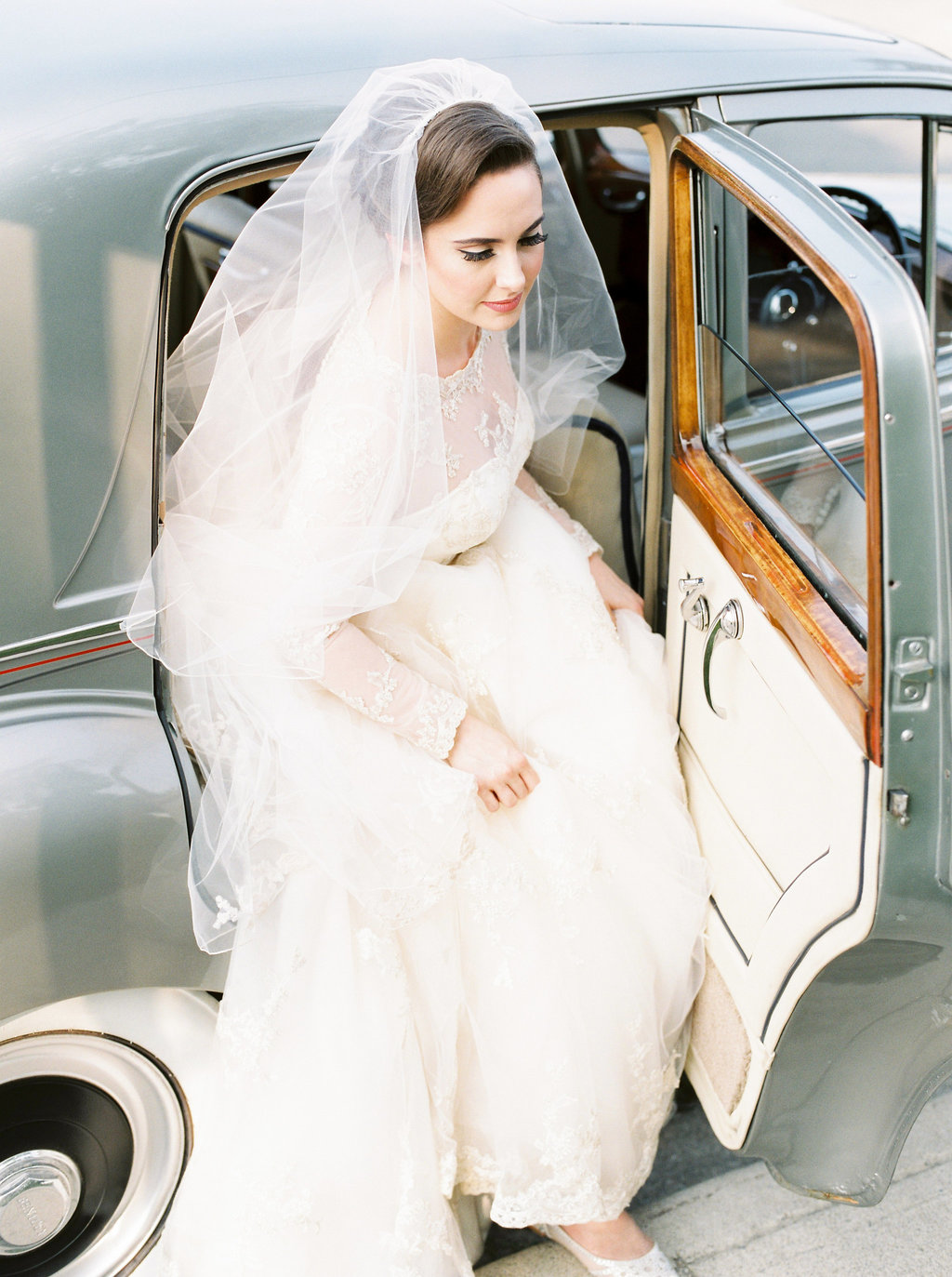 1cbd55e9304 Lindsey + Anthony  Traditional British Wedding - Bride stepping out of  Bentley